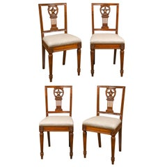 Set of Four Italian 1820s Neoclassical Dining Room Chairs with Carved Splats
