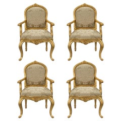 Set of Four Italian 18th Century Transitional Period Giltwood Armchairs