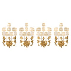Set of Four Italian 19th Century Roccoco Giltwood and Gilt Metal Sconces