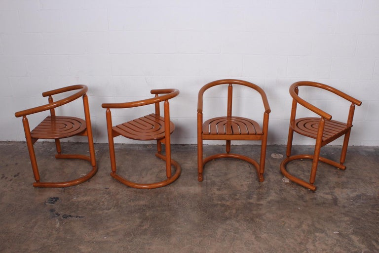 A set of four Italian dining / armchairs.