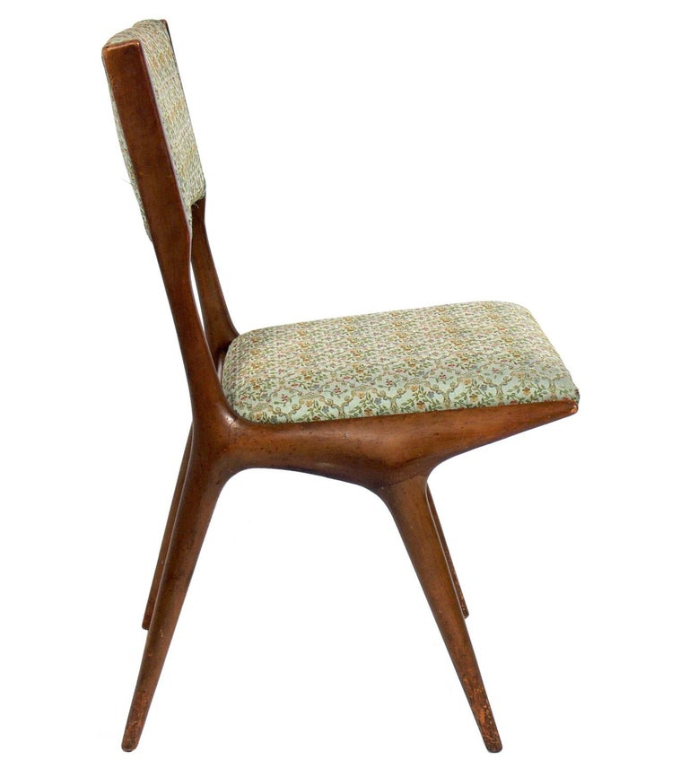 Set of four Italian dining chairs, designed by Carlo di Carli for Singer and Sons, Italy, circa 1950s. They are currently being reupholstered and can be completed in your fabric. The price noted includes reupholstery in your fabric (c.o.m.).
