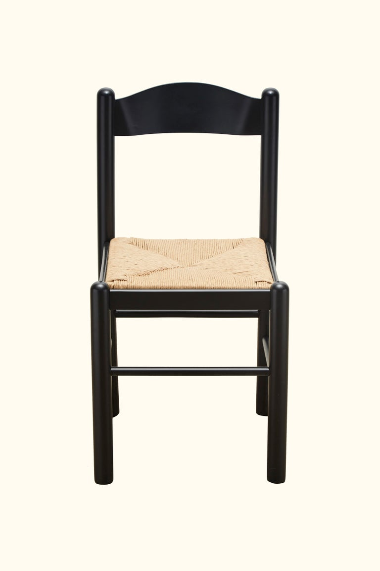 Set of four Italian dining chairs with rush seat.