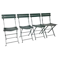 Set of Four Jacques Adnet Leather Folding Chairs
