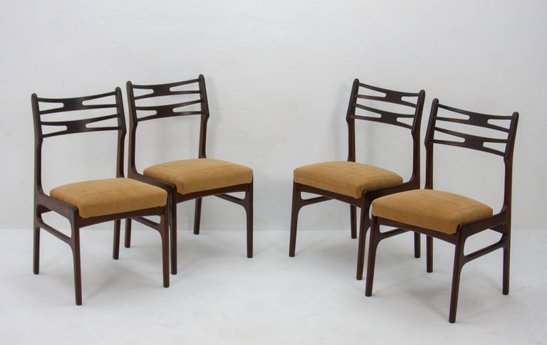 Four sophisticated model 101 dining chairs designed by Johannes Andersen for Vamo Sonderborg. Wonderfully crafted organically shaped teak frames.