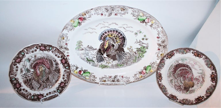 Large English Turkey platter, Johnson Bros. and a set of three English Autumn Monarch Turkey plates.  English hand engraved Johnson Bros. set of three plates. Decorated large and engraved turkey platter. Hand engraved and in great