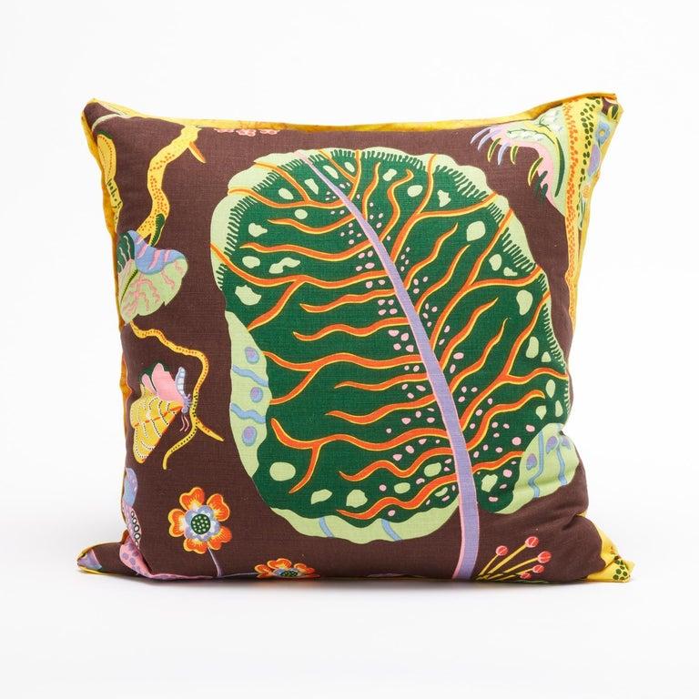 A set of four square cushions featuring vintage fabric by Austrian designer Josef Frank. Each cushion displays a design motif from Josef Frank's