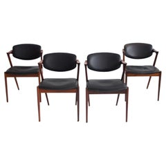 Set of Four Kai Kristiansen Model 42 Black Leather and Hardwood Chairs