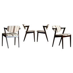Set of Four Kai Kristiansen Model 42 Dining Chairs in Rosewood Stained Oak