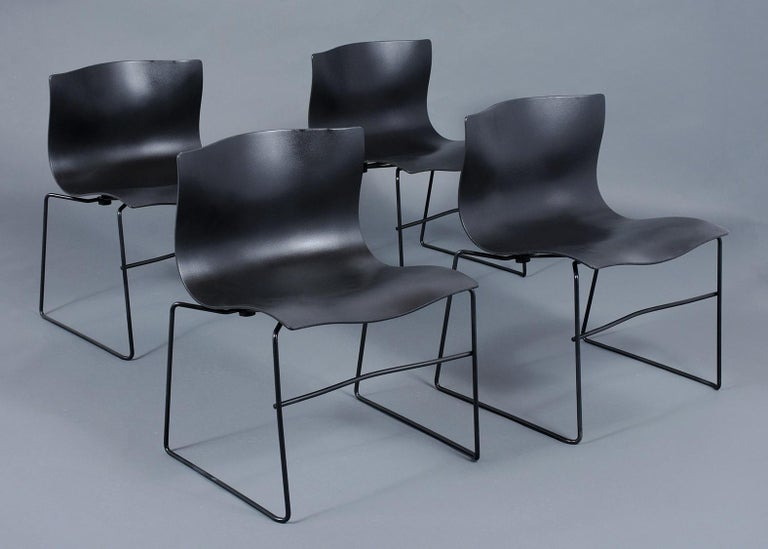 This set of four Knoll handkerchief chairs, designed by Massimo and Lella Vignelli are in great condition. These chairs are all are fully marked and in fine original condition and feature black seats resting on black metal bases. . These chairs