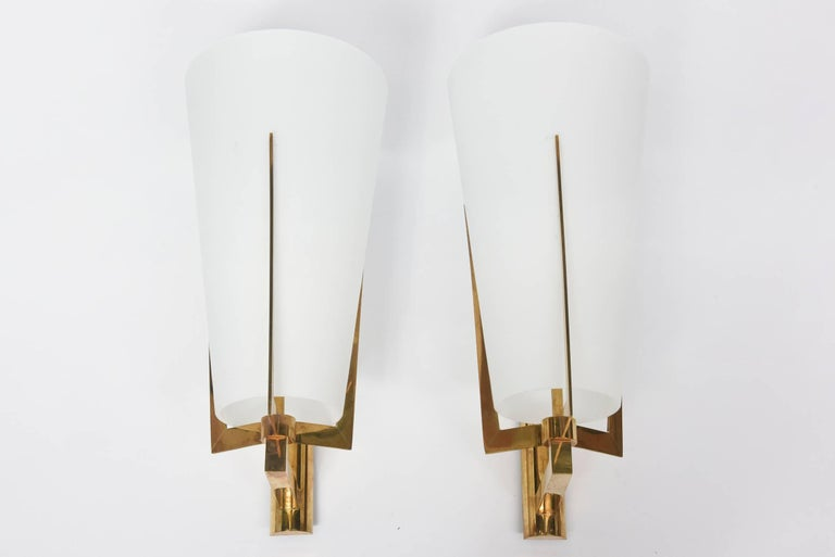 The frosted conical shade over a brass three pronged and armed structure. Rewired for US standards. Very fine overall condition. Glass with no chips, flakes, cracks, restorations.