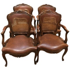 Set of Four Leather and Cane Louis XV Style Armchairs in Walnut