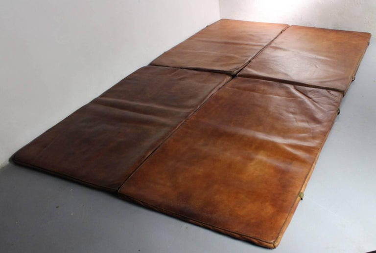 Set of four leather gym mats made in the 1930s. They have been made from thick leather, very good original condition.
