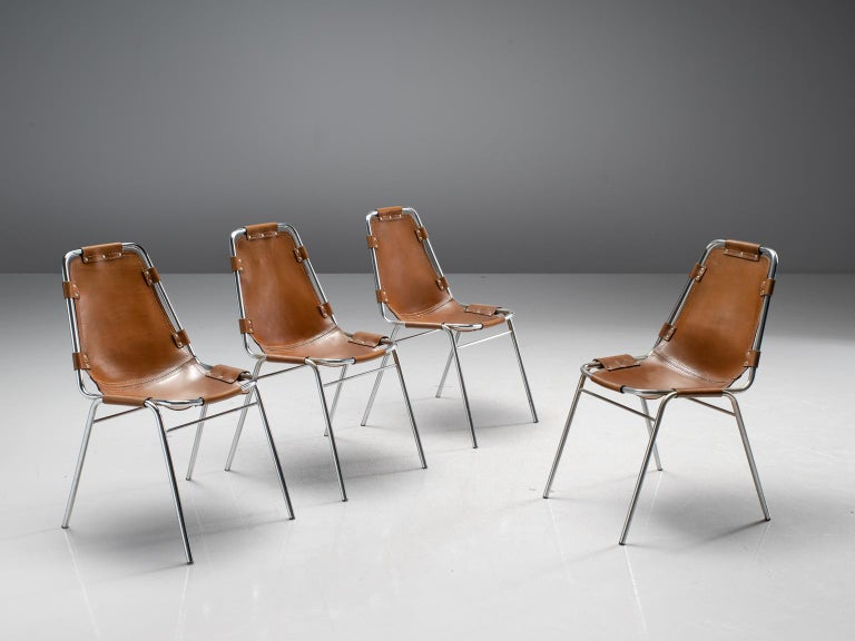 Set of four chairs 'les arcs', in steel and cognac leather, France, circa 1970s. 