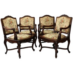 Set of Four Louis XV Rococo Style Carved Walnut Armchairs, circa 1860