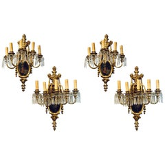 Set of Four Louis XVI Style Bronze and Crystal Rams Head Five Light Sconces