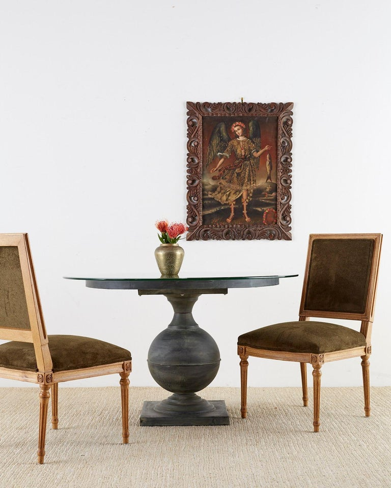 Elegant set of four French Louis XVI style dining chairs featuring new dark green velvet upholstery. The frames have a Classic square back and seat supported by tapered and fluted legs. The corners are decorated with a modern round design instead of