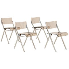 Set of Four Lucite Folding Chairs