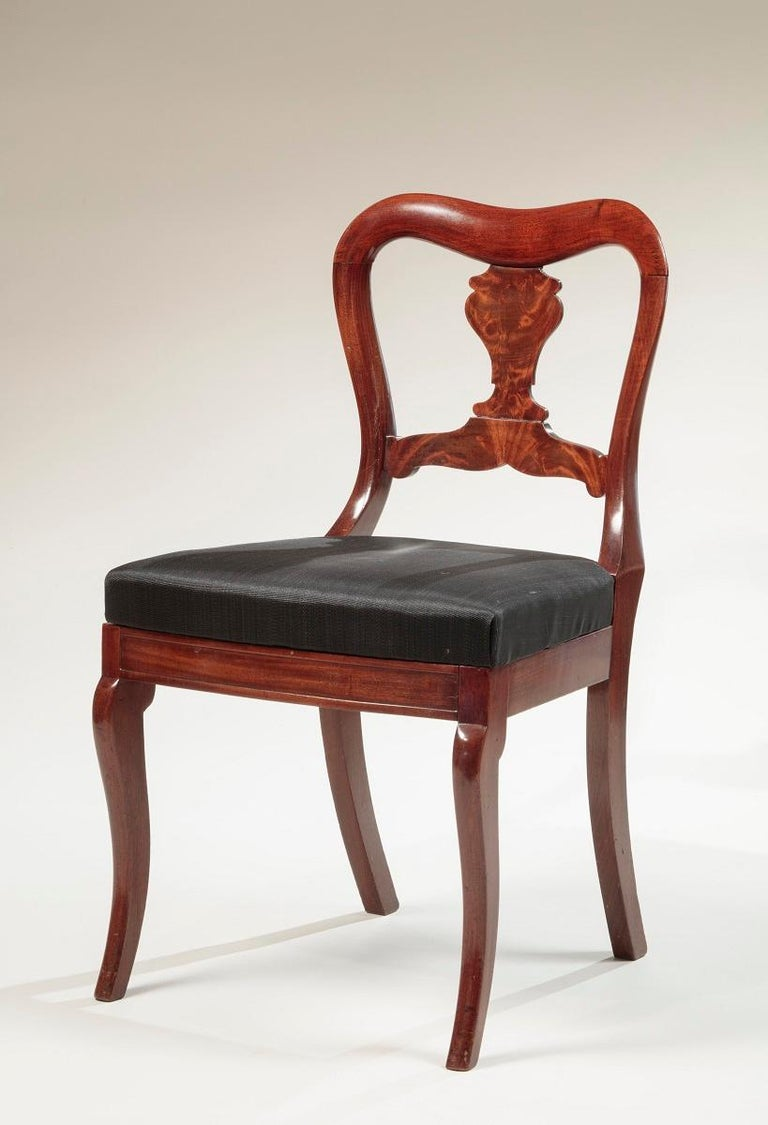Set of four Restauration mahogany dining chairs In the Manner of Duncan Phyfe (1770-1854) or D. Phyfe & Sons (active 1837-1840) New York, 1835-1840  Each with yoke-shaped crest rail and vase-shaped splat above an upholstered slip seat and bowed