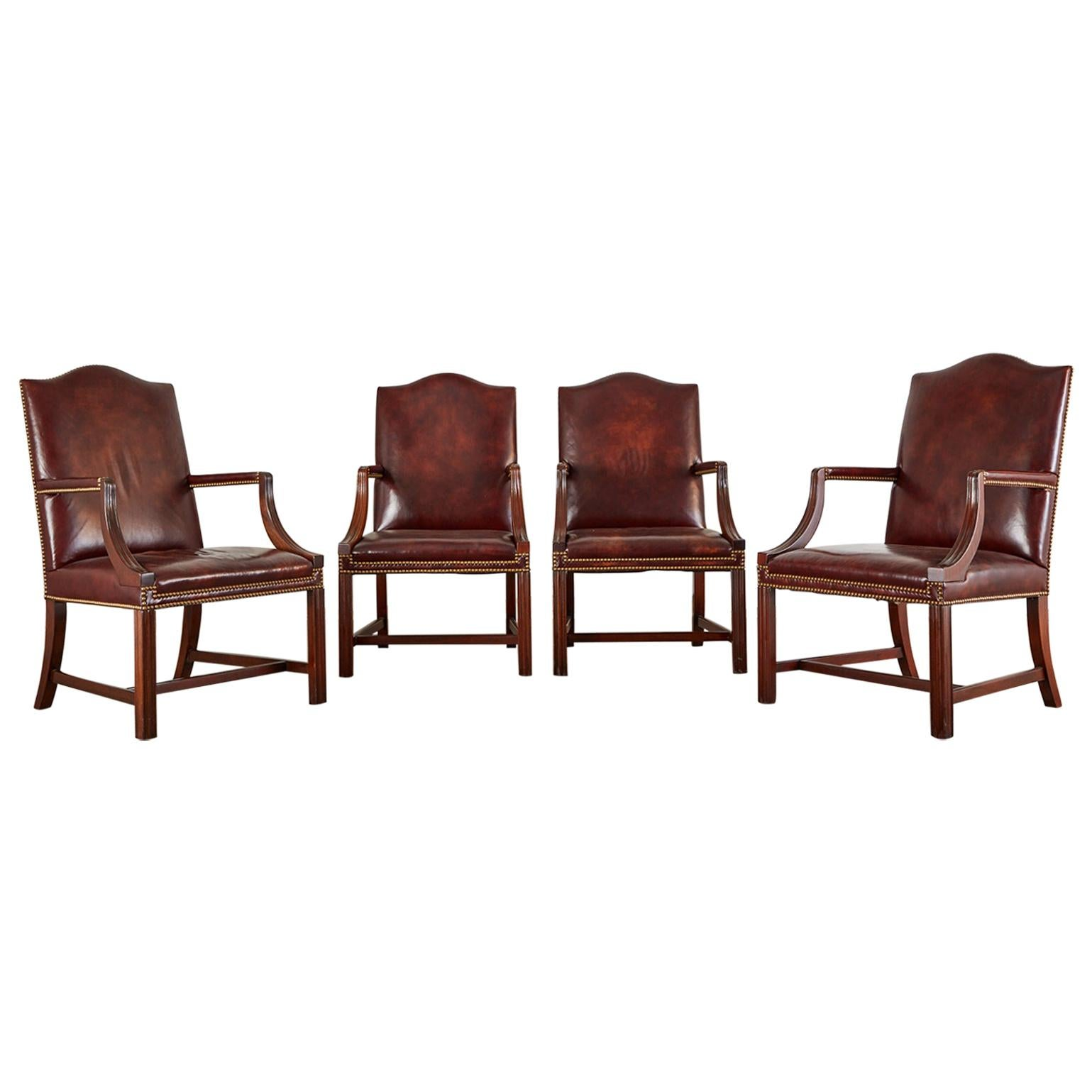 Set of Four Mahogany Gainsborough Leather Library Armchairs