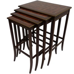 Set of Four Mahogany Nesting Tables with Brass Inlay and Trim, Mid-20th Century