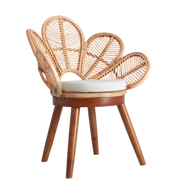Set of four gorgeous armchairs: rattan flower petal shaped seats, on mahogany wooden feets. They will be perfect on your terrace, in your veranda, around the swimming pool or the dining table. Poetic, elegant, aerial and colorful. All in excellent