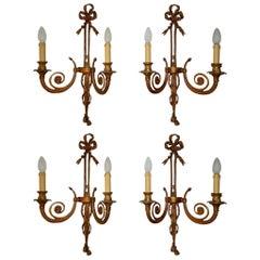 Set of Four Maison Baguès Style Cast Bronze Bows and Tassels Sconces, circa 1900