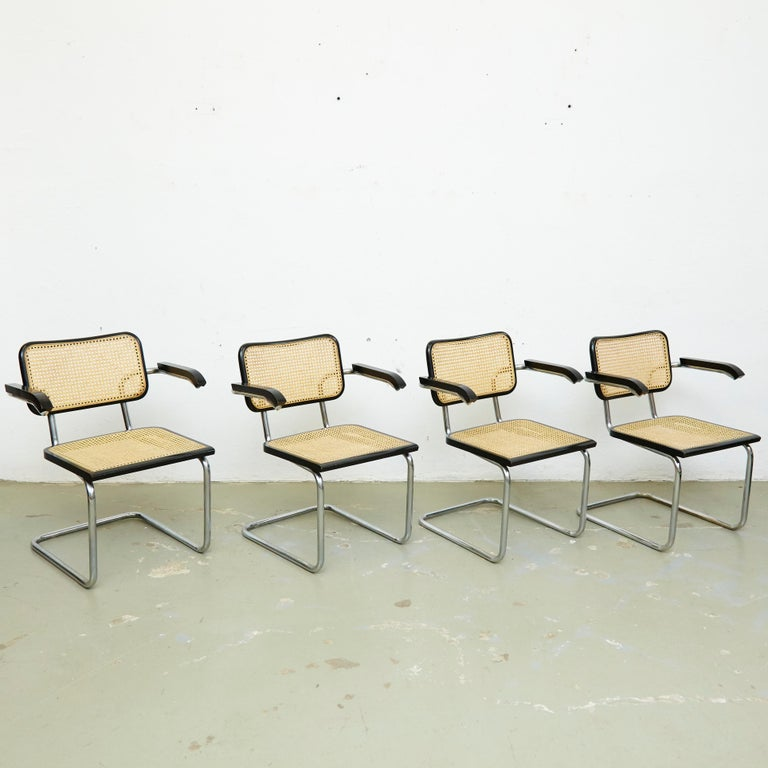 Set of four armchairs, model Cesca, designed by Marcel Breuer. Manufactured in Italy circa 1970 by unknown manufacturer.  Metal pipe frame, wood seat and back structure and rattan.  In good original condition, with minor wear consistent with