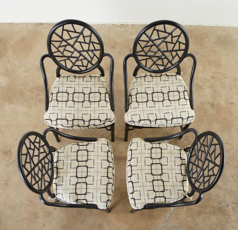 Genuine, authentic set of four California organic modern style bamboo rattan dining chairs made by McGuire. Designed by Elinor McGuire in 1968. The chair is known for its iconic