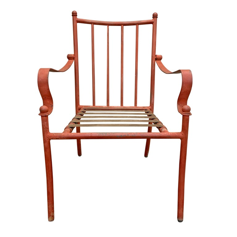 A wonderful set of four mid-20th century American iron frame patio chairs with fantastic scrolled arms, and tubular frames. These are really well constructed with solid materials and excellent attention to detail. We have plans to have these