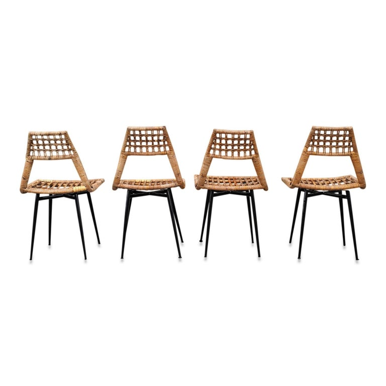 Wicker chairs in the style of Franco Albini Enameled steel feet structure rattan seating Top of back rest width is 9