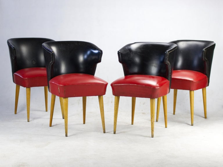 Theese chairs were used in the Nador café in Budapest during the 1960s and 1970s. Chairs were made in Hungary in the 1960s. Frame and the legs are made of beech and the upholstery is red and black leatherette. Signs of wear caused by years of use in