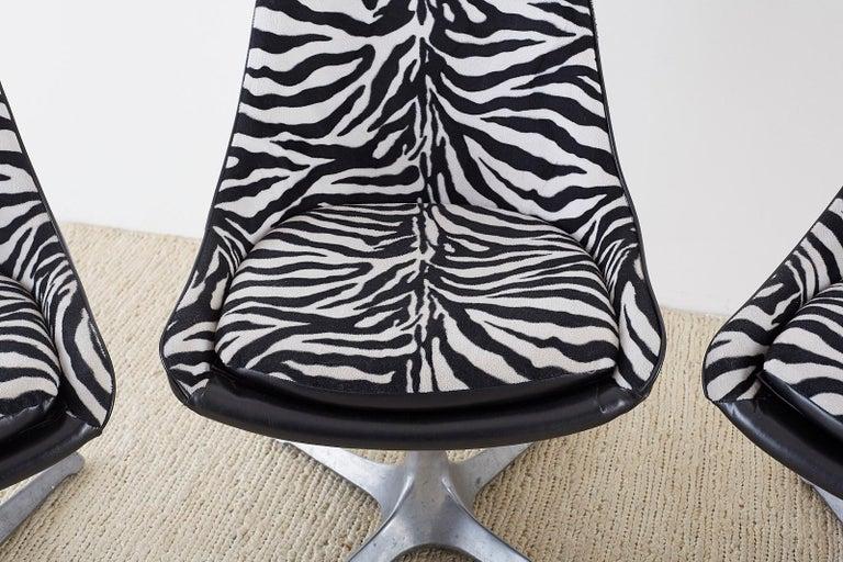 Polished Set of Four Midcentury Chromcraft Zebra Swivel Dining Chairs For Sale