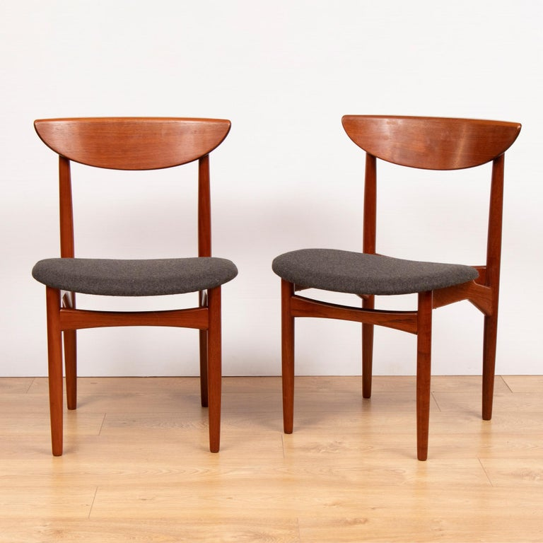 Extremely Rare Set of Four Mid Century Danish Teak Dining Chairs with a Curved Lipped Back and Charcoal Fabric Seats By Dyrlund.