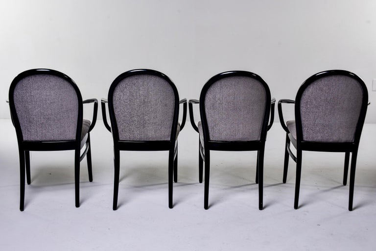 Found in England, this set of circa 1960s bentwood armchairs were professionally ebonized and reupholstered in a gray chenille velvet. Unknown maker. Sold and priced as a set of four.
