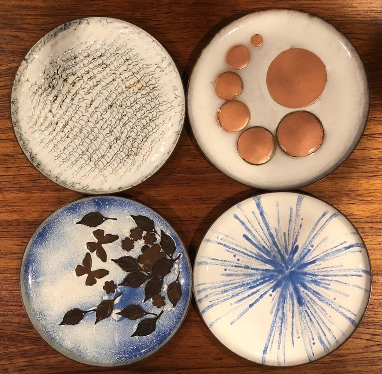 Gorgeous set of four Mid-Century Modern enamel on copper plates, circa 1960s. The plates are in very good condition and measure 5.75