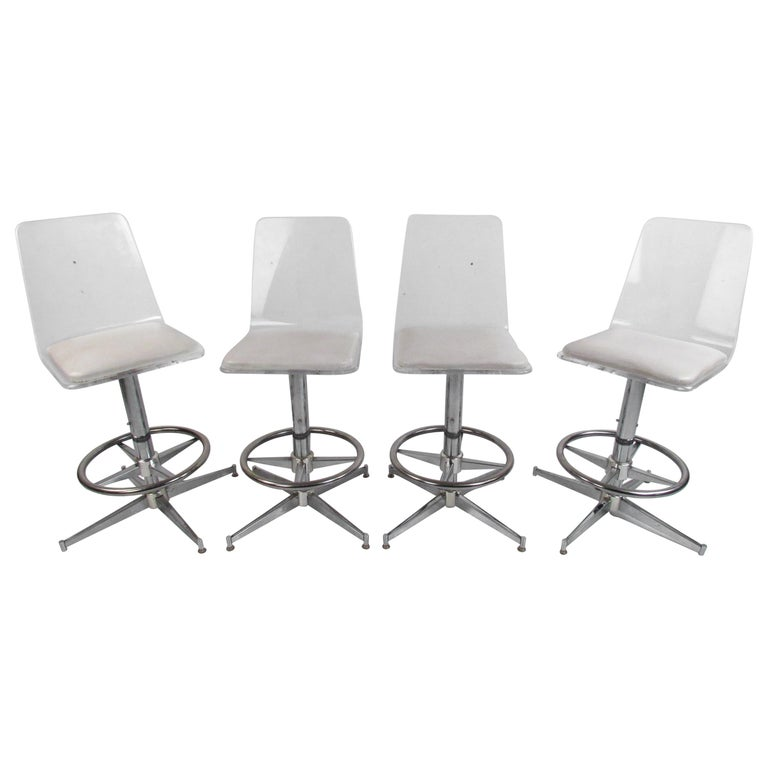 Set of Four Mid-Century Modern Lucite Swivel Bar Stools For Sale
