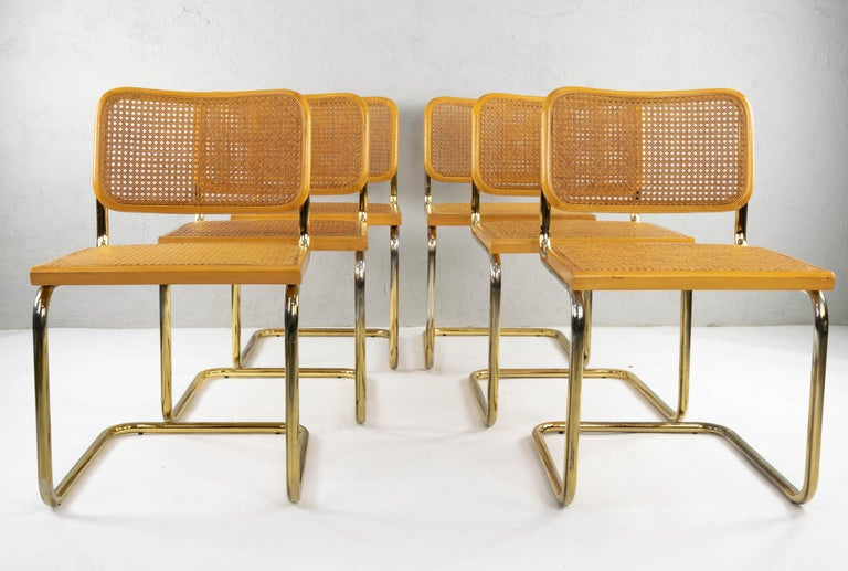 Set of six Cesca chairs model B32, Italy in the 1970s. Brass steel tubular structure. Blonde beech wood frames and Viennese natural grid. Grids in good condition. The brass has areas of wear as indicated in the images.