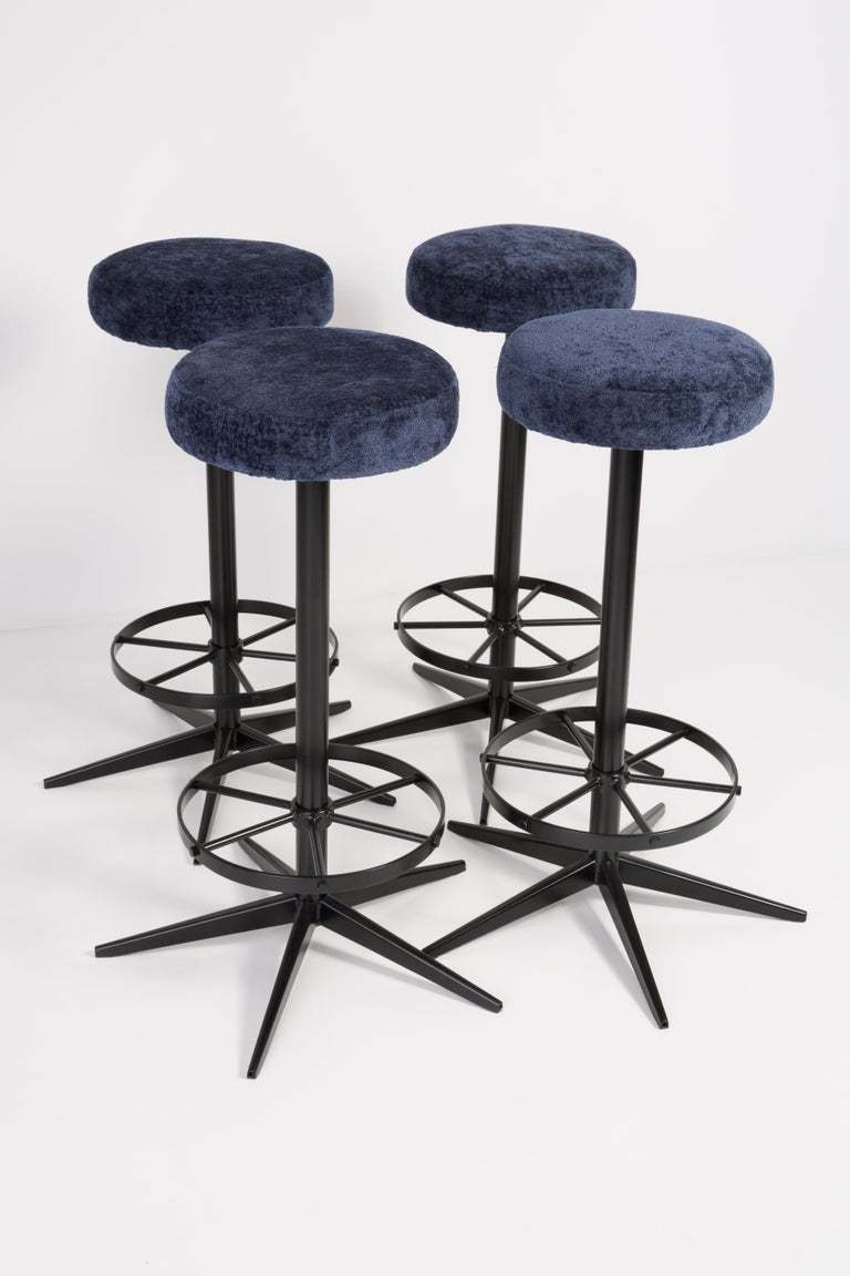 Stools from the turn of the 1960s. Produced in Germany Beautiful, well crafted dark blue upholstery. The stools consists of an upholstered part, a seat and steel black legs. They are not regulated. The height is constant.