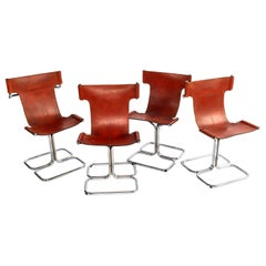 Set of Four Mid-Century Modern T Chairs in Chrome and Cognac Leather.