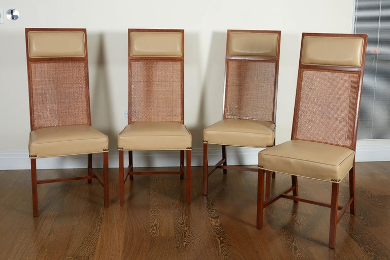 Each with high caned back with a leather headrest and upholstered seat; raised on straight legs joined by H-form stretchers. Sleek, stylish design. Beautifully upholstered in beige leather.