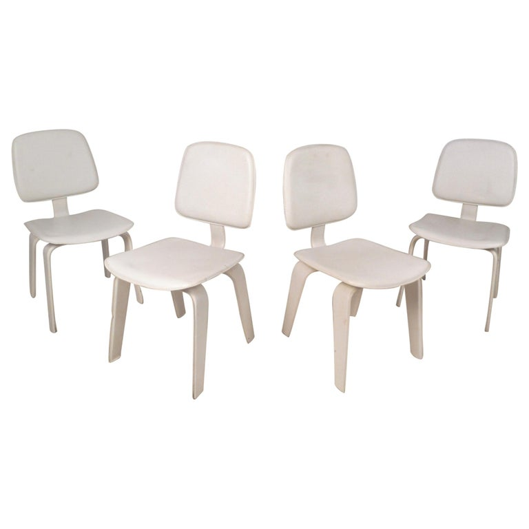 Set Of Four Mid Century Modern White Leather Dining Chairs For Sale