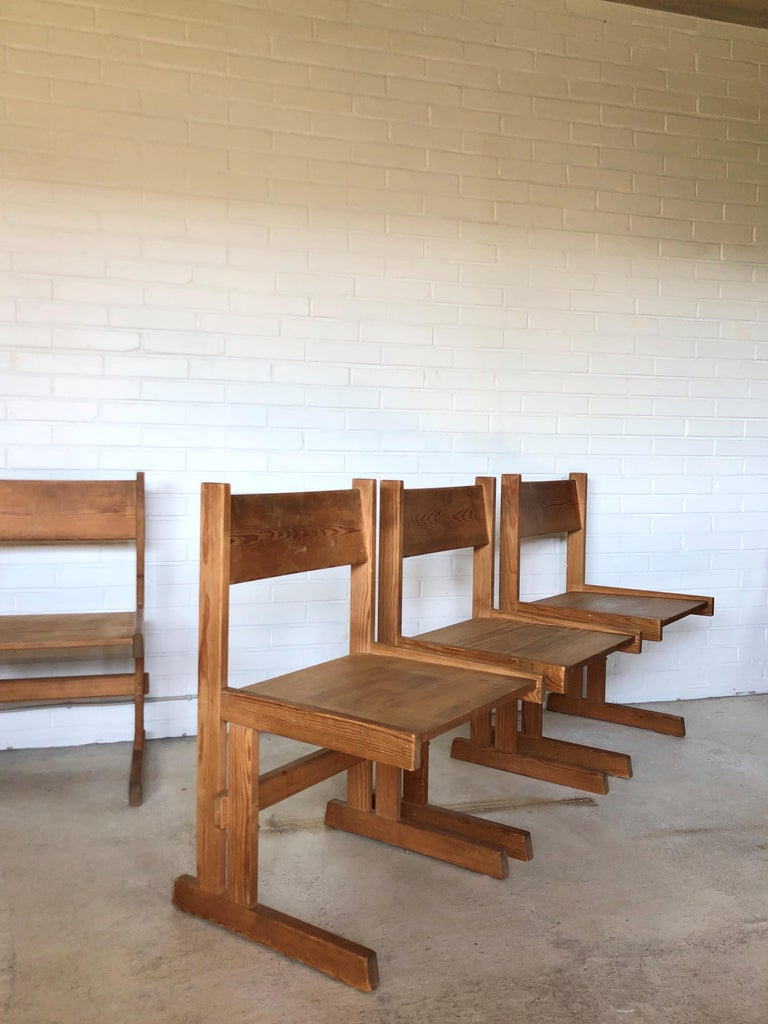 Set of four midcentury solid oregon pine chairs from a Danish furniture designer. Stamped at the bottom in Danish 'Bo med fyr'. Designed 1960s.  In this design you recognize the style of Børge Mogensen, Rainer Daumiller or Pierre