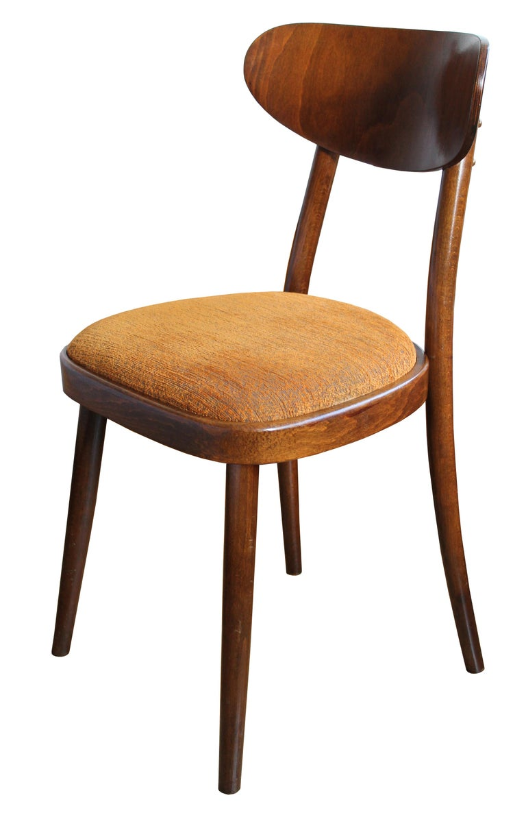 These simple and elegant dining chairs were designed and produced by TON Company in Czechoslovakia. The shape of these chairs is based on the traditional Thonet/TON dining chair. The bentwood backrest however is a typical design aesthetic of the