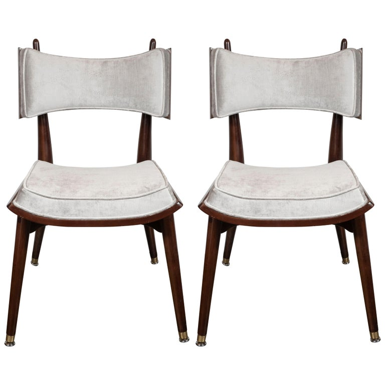 This rare and dramatic set of four game chairs were realized by the esteemed Mid-Century Modern Designer Harold Schwartz for the Romweber Furniture Co. in America, circa 1960. Handmade in handrubbed walnut with brass details throughout, two of the