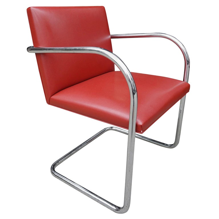 Special order red leather chairs upholstered by Knoll. Beautiful showing very little use.