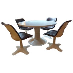 Set of four Midcentury Leather Dining Chairs and a table by Yrjö Kukkapuro