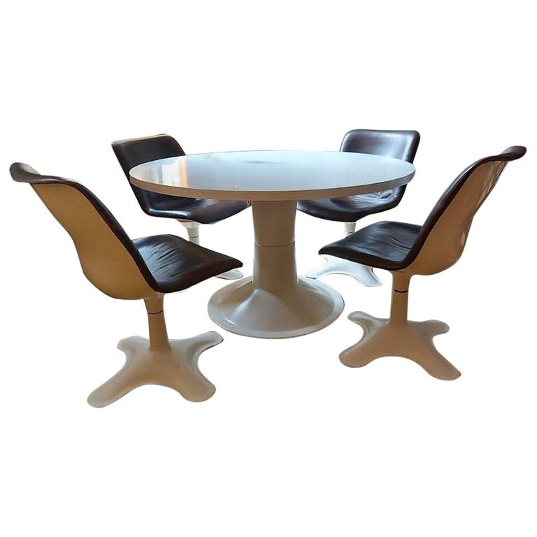 Set of four Midcentury Leather Dining Chairs and a table by Yrjö Kukkapuro For Sale