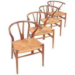 Set of Four Midcentury Wishbone Chairs in Patinated Oak by Hans Wegner, 1960s