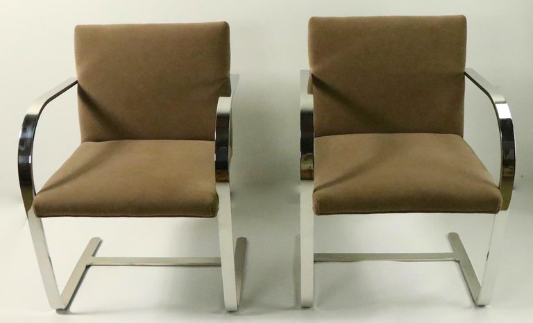 Excellent quality set of Brno chairs designed by Ludwig Mies van der Rohe and executed by Brueton. These chairs are in very good, original and clean condition. Upholstered in faux suede, with heavy solid stock flat bar polished steel frames.