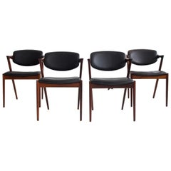 Set of Four Model 42 Black Leather and Hardwood Chairs by Kai Kristiansen
